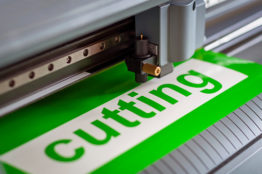 Cutting plotter close-up. The process of cutting a vinyl film.