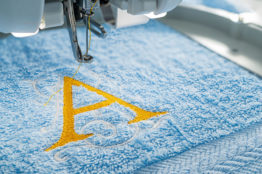 Close,Up,Picture,Of,Embroidery,Machine,And,Yellow,Monogram,A