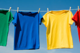 A,Set,Of,Primary,Colored,T-shirts,Hanging,On,A,Clothesline